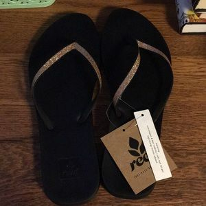 Reef brand black sandals with gold glitter